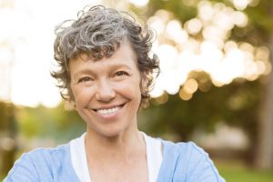 Learn more about the benefits of implant-retained dentures in Spring, TX.